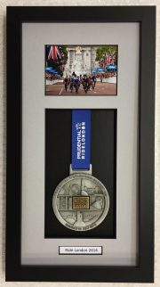Presidential Ride London memorabilia medal in a black frame with a grey mount