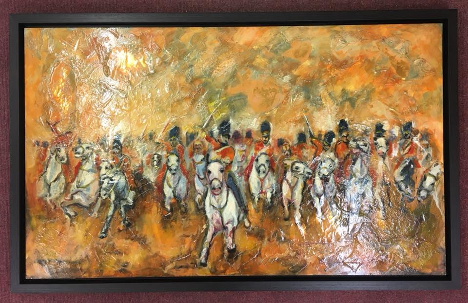Painting of a cavalry in a black frame