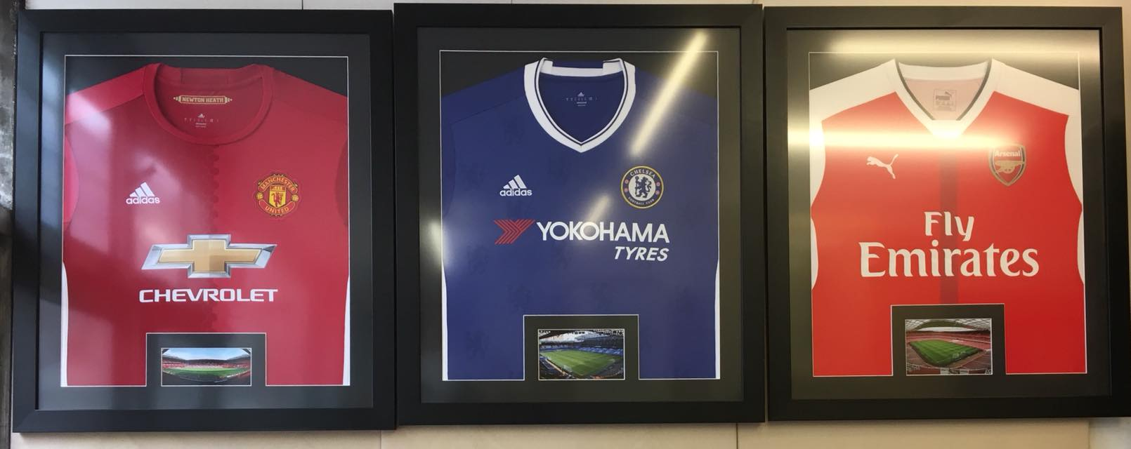 Manchester united, Chelsea, and Arsenal shirt in 3 individual black frames with black mounts
