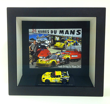Le Mans 2012 toy car in a black frame